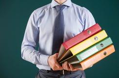 Businessman holding folders Royalty Free Stock Image