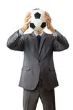 Businessman holding football Royalty Free Stock Photography
