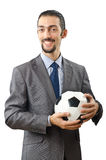 Businessman holding football Stock Photography