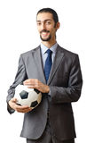 Businessman holding football Stock Photos