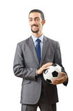 Businessman holding football Royalty Free Stock Images
