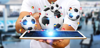 Businessman holding football in his hand Royalty Free Stock Image