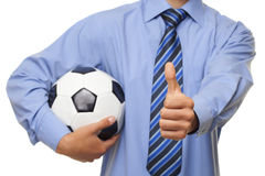 Businessman holding football Royalty Free Stock Photo