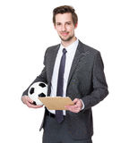 Businessman holding football on white Royalty Free Stock Photo