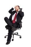Businessman holding forehead Stock Photos