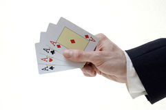 Businessman holding four aces Royalty Free Stock Images