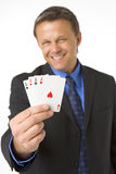 Businessman Holding Four Aces Stock Image