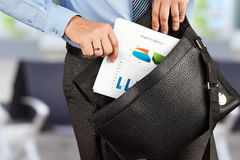 Businessman holding and geting out   documents with graphs  from Stock Photography