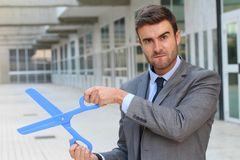Businessman holding a giant pair of scissors Royalty Free Stock Photo