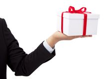 Businessman holding a gift Royalty Free Stock Photo