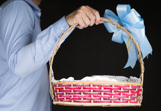 Businessman holding Gift Baskets in background Stock Images