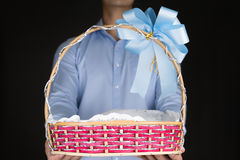Businessman holding Gift Baskets in background Stock Photos