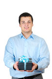 Businessman holding gift box Stock Photos
