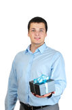 Businessman holding gift box Royalty Free Stock Image