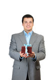 Businessman holding gift box Stock Photography