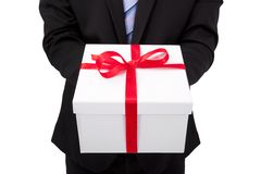 Businessman holding gift box Stock Image