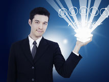 Businessman holding gift box Stock Photo