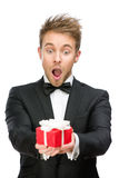 Businessman holding gift box Royalty Free Stock Photo