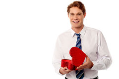 Businessman holding gift box Royalty Free Stock Images