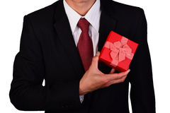 Businessman holding a gift box isolated Stock Photography