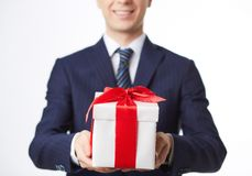 Businessman holding gift. Image of giftbox held by smiling businessman Royalty Free Stock Photos