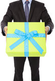 Businessman holding a gift. isolated on white Royalty Free Stock Image