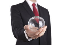 Businessman holding a glass ball isolated on white. Clipping path included stock photography