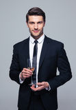 Businessman holding glass of champagne Stock Image
