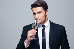 Businessman holding glass of champagne Stock Photo