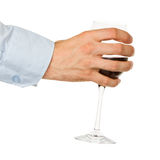 Businessman holding a glass of red wine Royalty Free Stock Photo