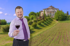Businessman holding glass of wine with beautiful Royalty Free Stock Image