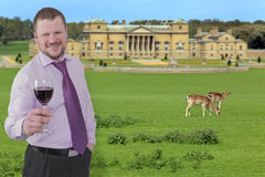 Businessman holding glass of wine with beautiful Stock Photography