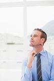 Businessman holding glasses in day dreaming Royalty Free Stock Photos