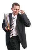 Businessman holding glasses and folder. Studio shot royalty free stock images
