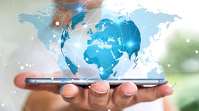 Businessman holding global network on planet earth 3D rendering. Businessman holding global network and data exchanges over his phone 3D rendering Stock Photos