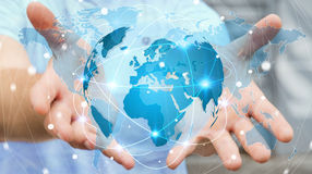 Businessman holding global network on planet earth 3D rendering. Businessman holding global network and data exchanges over the world 3D rendering Royalty Free Stock Photos