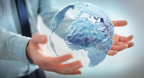 Businessman holding global network on planet earth 3D rendering. Businessman holding global network and data exchanges over the world 3D rendering Stock Photos
