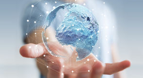 Businessman holding global network on planet earth 3D rendering. Businessman holding global network and data exchanges over the world 3D rendering Royalty Free Stock Image