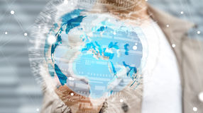 Businessman holding global network on planet earth 3D rendering. Businessman touching global network and data exchanges with a digital pen 3D rendering Stock Photo