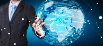 Businessman holding global network on planet earth 3D rendering Stock Photo