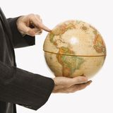 Businessman holding globe. Stock Photo