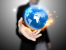 Businessman holding globe. Businessman holding a glowing, connected Stock Photos