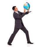 Businessman holding  globe Royalty Free Stock Images