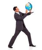 Businessman holding  globe Royalty Free Stock Images