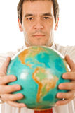 Businessman holding the globe Stock Image