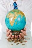Businessman holding globe Stock Image