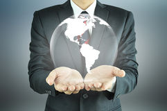 Businessman holding the globe Royalty Free Stock Photography
