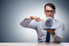 The businessman holding globe in global business concept Royalty Free Stock Image