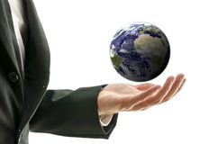 Businessman holding globe Stock Photos