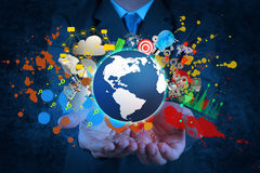 Businessman holding a glowing earth globe Royalty Free Stock Images